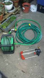 Long hose with sprinkler system