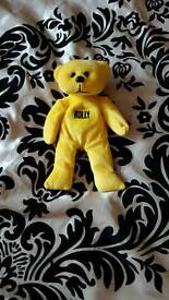 new yellow teddy with name holly.