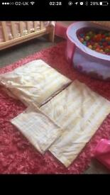 Yellow hand towels and king size duvet and pillowcase bed set