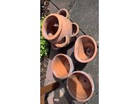 Terracotta plant pots and strawberry planter