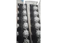 "Black and silver eyelet curtains 67"" width 72"" drop"
