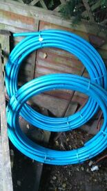 2 x25 metre rolls of 25mm water pipe plus stop taps