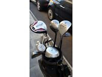 Golf clubs, balls and carry bag