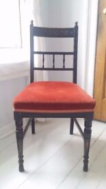 Beautiful antique/vintage black chair with red seat