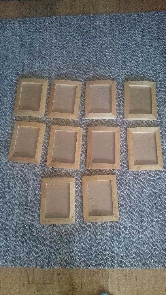 Set of 10 matching wooden wall photo frames