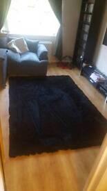 Large black rug