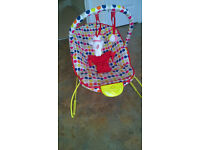 Multi-coloured baby bouncer/rocker with music and vibrations