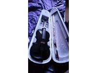 Barely used violin. Full size, black .