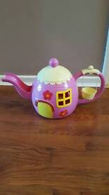 Pink teapot with cups