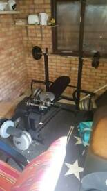 Weights bench/ bar bell and dumb bells