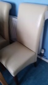 Cream leather dining chairs x4
