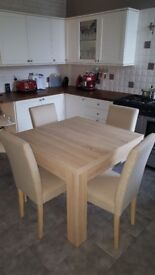 Dining table with 4 cream chairs. Great condition