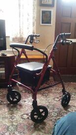 Brand new. Never used. Lightweight alluminium rollator. Ruby red. Loop lockable brakes.