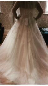 Wedding dress from brides of Chester size 14 .