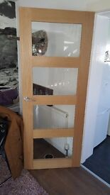 Oak panelled door with clear glass