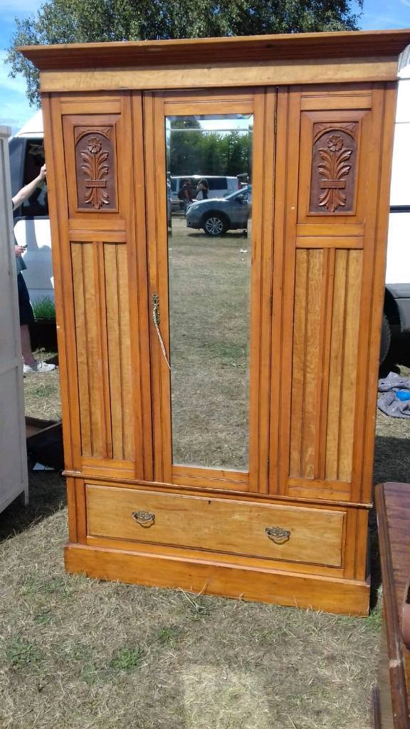 Antique Pine mirrored wardrobe with single drawer.