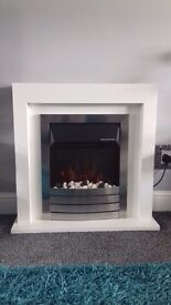 White fireplace and electric fire