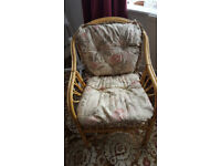 Wicker chair with padded cushion