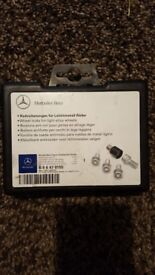 Genuine mercedes locking wheel nuts and key brand new in box