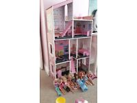 tall dolls house in lovely condition with lots of good clean barbie dolls and accesories