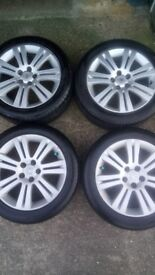 Vauxhall 17 inch alloy wheels nearly new tyres 5x110 good condition