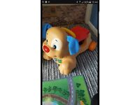 Fisher price ride on activity dog