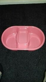 Pink mothercare bath tub and top 'n' tail bowl comes with floating themometer.