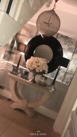 Moderno stone finish console table and the coach house Venetian black mirror .