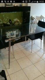 GLASS DINING TABLE WITH A CHROME SILVER LEGS