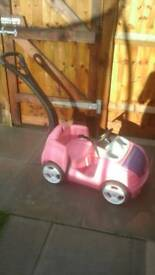 Pink push along car with handle