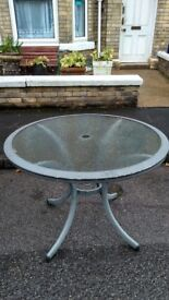 Circular glass outdoor table with