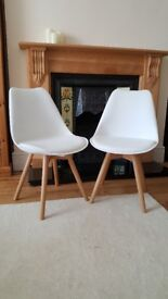 2 white modern dining chairs