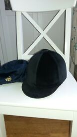 Excellent condition riding helmet, with waterproof cover