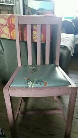 Vintage painted chair with oilcloth seat