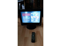 15 Inch Portable TV from Next with built in DVD player, has its remote. Excellent condition.
