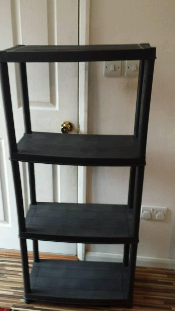 Plastic shelves unit