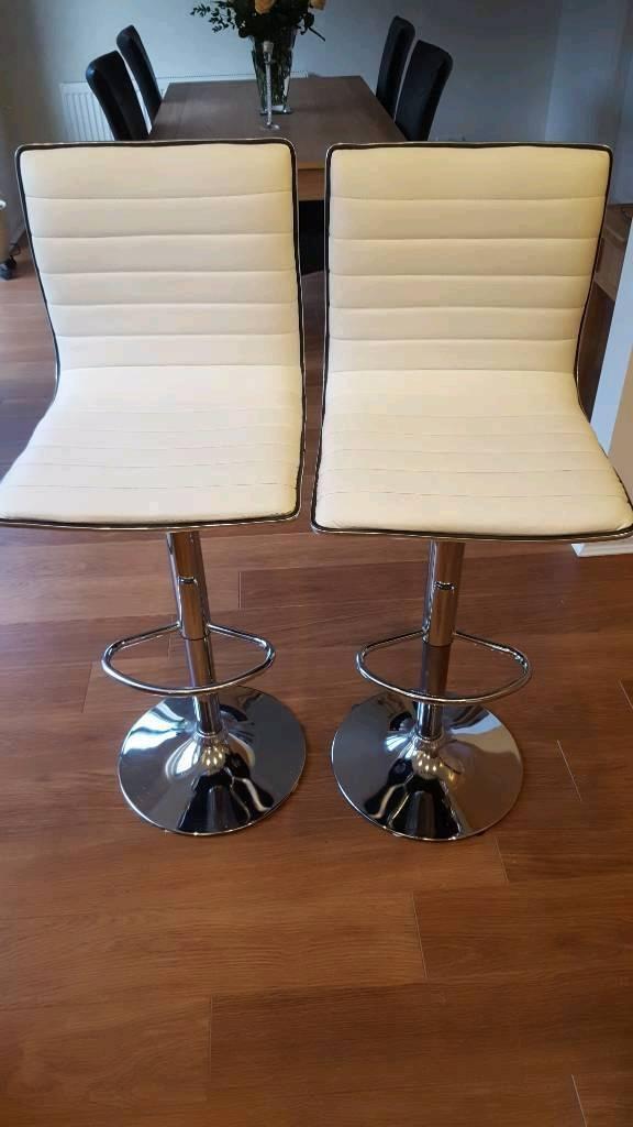2 cream bar stools