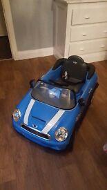 Blue electric ride on in mini cooper