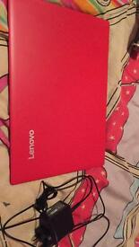 Red Lenovo Ideapad 100S laptop