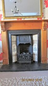 Victorian style cast iron fireplace with tiles and pine surround. 120 cm width, 115 cm height.