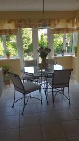 Glass top wrought iron table with chairs