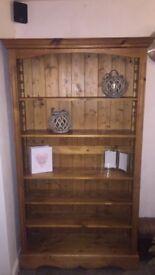 Solid wood shelving unit.