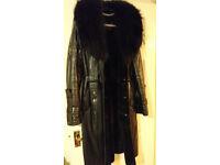 Black coloured Shipskincoat, real leather natural fur, size M