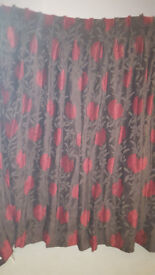 Brown curtains with a red flower