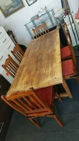 Solid wood farm house table and 6 chairs
