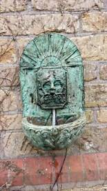 """Carved stone """"green man"""" wall fountain"""