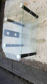 Glass tv stand with black legs