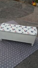 Upcycled laundry or storage container. Painted off white and covered in chicken pattern oilcloth