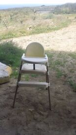 high chair cream with wooden legs used