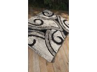 Monochromatic Abstract Rug - Perfect for placing under a table or just on its own!